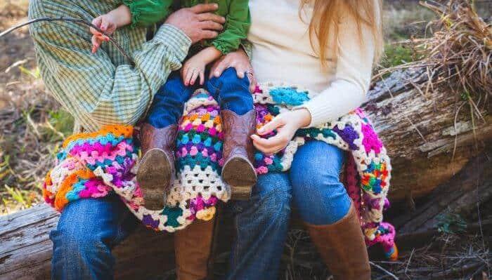 family with crochet blanket