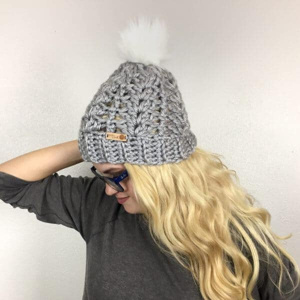 MCKENNA WOMEN'S BEANIE CROCHET PATTERN | This lovely women's winter hat is a great, everyday go-to! The ribbed brim offers the perfect stretch and warmth for even the coldest of days while the lacy shell pattern makes it a beautiful accessory to your casual cold-weather outfits. Top it with a faux fur pom, a matching pom or leave plain - whatever your choice, this hat is stunning. A quick and easy crochet, you can complete this hat in about an hour!