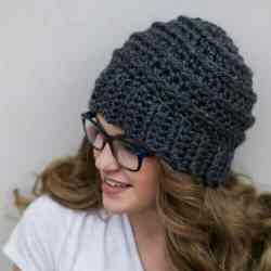 Photo of a woman wearing the crocheted Beehive Beanie
