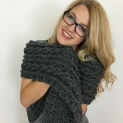 There is nothing cozier than an oversized Celtic cable scarf and this one is so easy to make. You'll be amazed! #freecrochetpattern #cablestitch #crochetpattern #cablescarf #oversizedscarf #celticscarf #stpatricksdaycrochet #stpatricksday #celticcrochet #celtic #cablestitchscarf