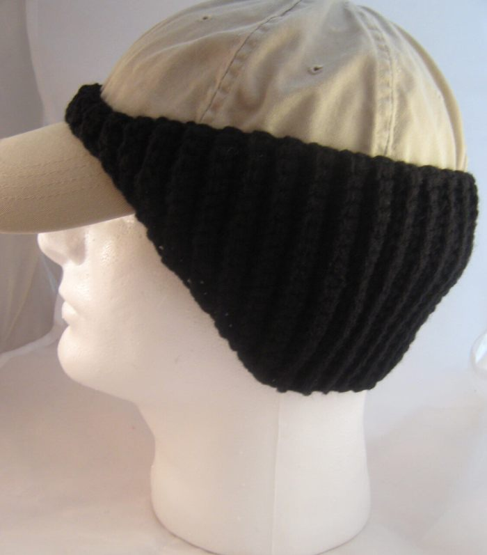 Photo of a cap on a mannequin head with a crocheted baseball cap ear warmer