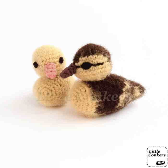 Photo of two realistic crocheted duckling