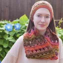 Photo of a woman wearing the Autumn Adventure Cowl around her neck