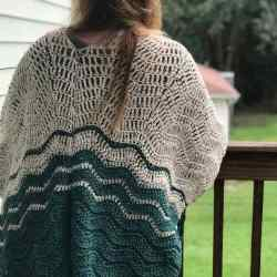 A free beginner ripple blanket wrap crochet pattern! Super easy to make, super cozy to wear. Make yours today with this free crochet pattern. #rippleblanket #crochetpattern #rippleblanketwrap #freecrochetpattern #30daysofcozy #hooknsteindesigns #crochetpreneur