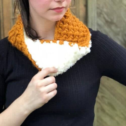 Free Cozy Reversible Cowl Crochet Pattern - it's luxury at its finest with this highly textured, two-toned beauty. Easy enough for a beginner. You'll want to make one for everyone on your list! #reversiblecowl #mobiuscowl #crochetpattern #freecrochetpattern #reversiblecowlcrochetpattern #bernatpipsqueak #wintercowl #chunkycowl #crochetpreneur #thecraftyreview #30daysofcozy