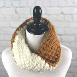 A photo of the crocheted infinity Cozy Reversible Cowl on a mannequin
