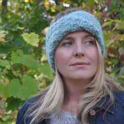 Photo of a woman wearing the Brianna Turban Headband Crochet Pattern