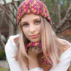 Photo of a woman wearing the crocheted Popcorn Cozy Beanie