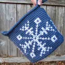 Image of a blue Snowflake Basket Tapestry Crochet Pattern