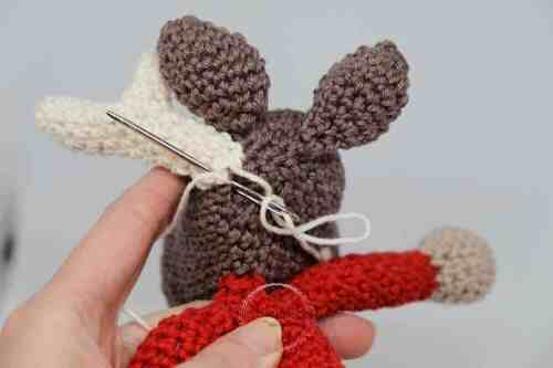 Instructional image while assembling the Einar Christmas Elk FREE Amigurumi Crochet Pattern