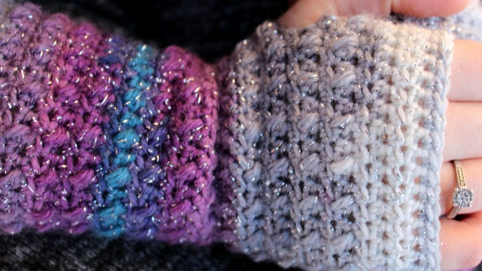 Up close photo of a gently ribbed self-striping crochet fingerless glove.