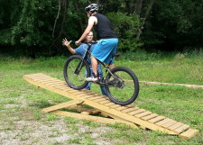 Galen Murray riding the mtb teeter totter in Sechler Park