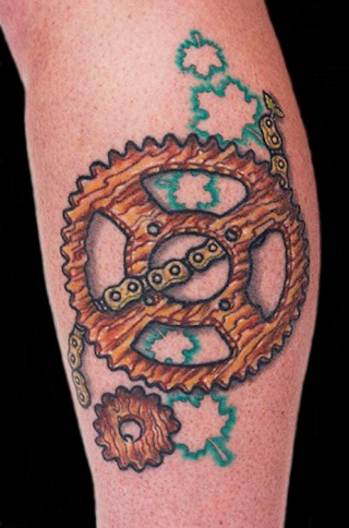 Wooden bike chain and sprocket on Kim. Outside calf. 2011