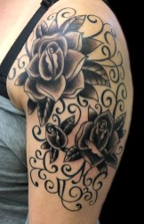 Traditional rose half sleeve with hidden initials (M and C on bottom). 2017