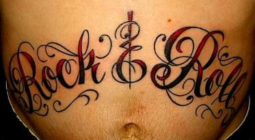 'Rock and Roll' in fancy script on stomach. 2007