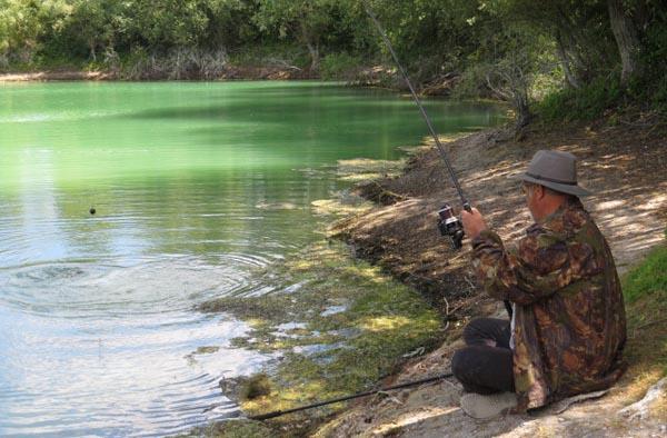 Landing a carp on Croix Blanche Lake