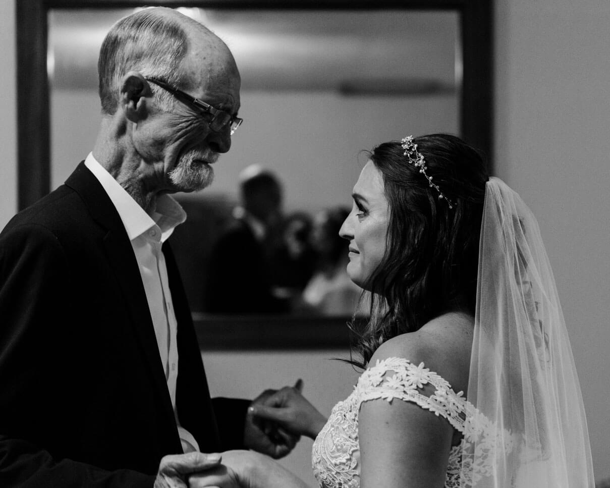 Bride and her Father Share a Moment before He Gives her Away