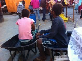 Wheelbarrows double as chairs when you're on break.