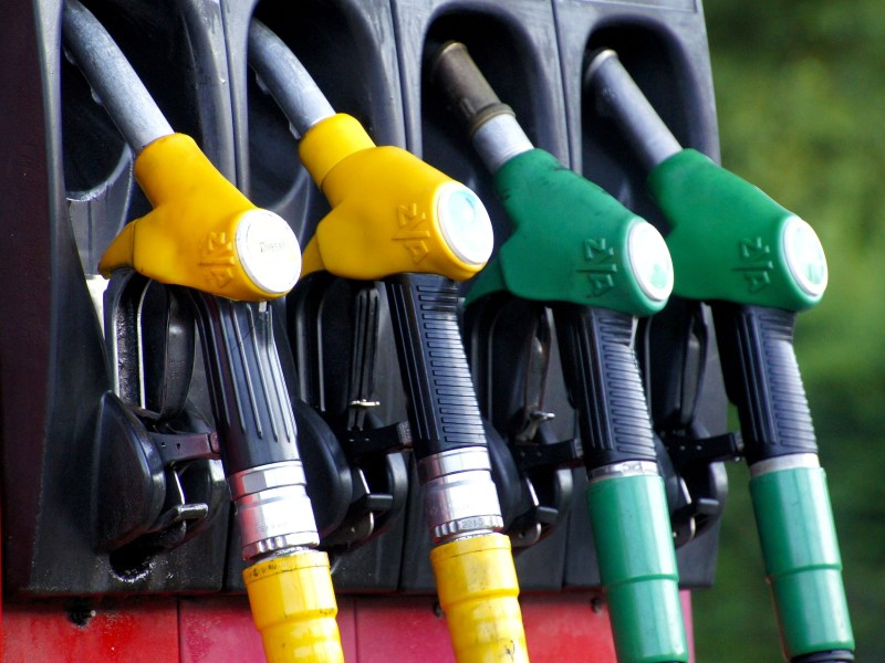 yellow and green gasoline pumps
