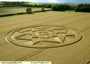 The Rollright Stones, Nr Little Compton, Oxfordshire. 5th August. Wheat. c.140 feet (43m) A complex formation with octagonal geometry. A standing woven ring of wheat encircles the centre, the perimeter of which has curiously folded wheat.