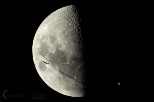 A plane crosses in front of the Moon as it eclipses Jupiter and its moons