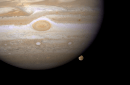 Ganymede peeks our from Jupiter