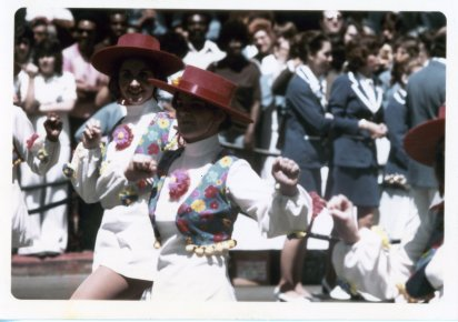 Elizabeth marching down the streets of San Diego with Barbara Fox and Robin Stephens in the background with President Ikeda.