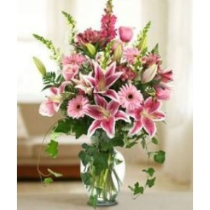 Stargazer lily snapdragon gerbera daisy vase arrangement