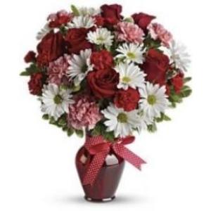 red roses white daisy red vase arrangement