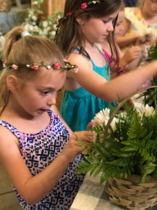 girl making an arrangement with ferns
