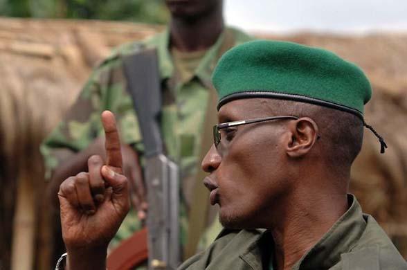 The main Tutsi militia leader in eastern Congo, Laurent Nkunda, gestures at his mountain base, in Kachanga