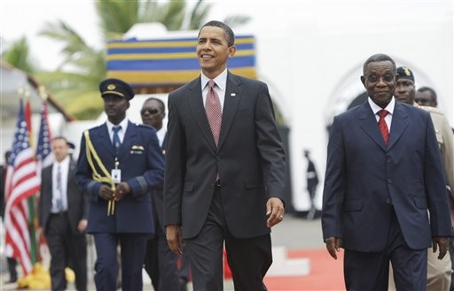 President Barack Obama walks with Ghana President John Atta Mills, right, at the Presidential Palace in Accra, Ghana, Saturday, July 11, 2009. In his first visit to sub-Saharan Africa since taking office.
