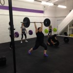Olympic lifting - a clean and jerk in a CrossFit class.