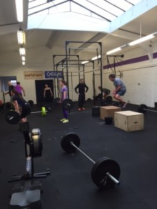 Scott coaching the class through a cheeky triplet of running, deadlifting and box jump overs
