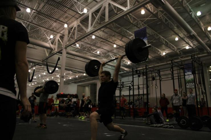 Bryce puts some weight overhead during the clean + FS + jerk ladder at the Team Grit comp in Hampton Roads