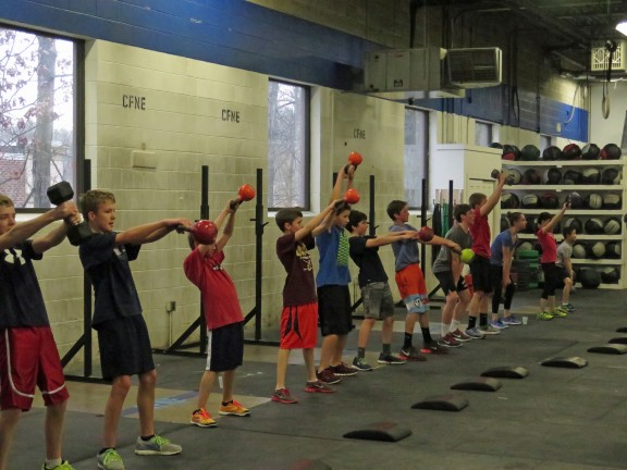 Middle School Class crushing some Kettlebell Swings.