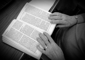 Elderly woman reading her Bible, Can technology give spiritual direction?