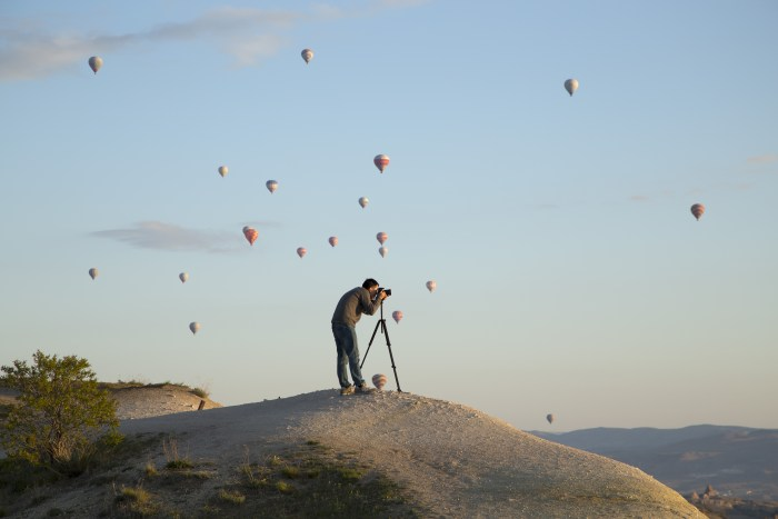 Photographer and hot air balloons