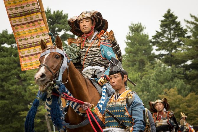 Steady samurai ride unruly horses.