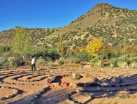 1 person waking a Sedona 7-path labyrinth. This is a ceremony to walk your new path during shamanic journey outdoor workshops in Sedona.