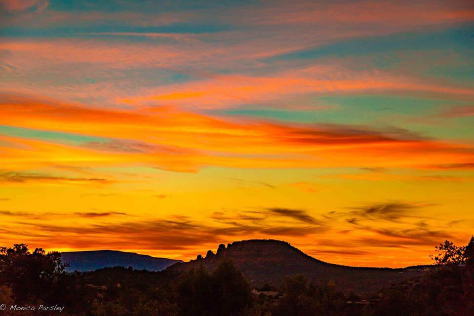Sedona sunset with vivid teal and peach colors symbolizes inspirational Sedona fall mystic vision retreats and special outdoor circles