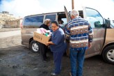 Unloading Sandra's van above (photos by Jackie Kleiger) and our other delivery vehicles.