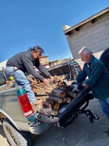 Hopi winter heat project--unloading wood at home of elder.