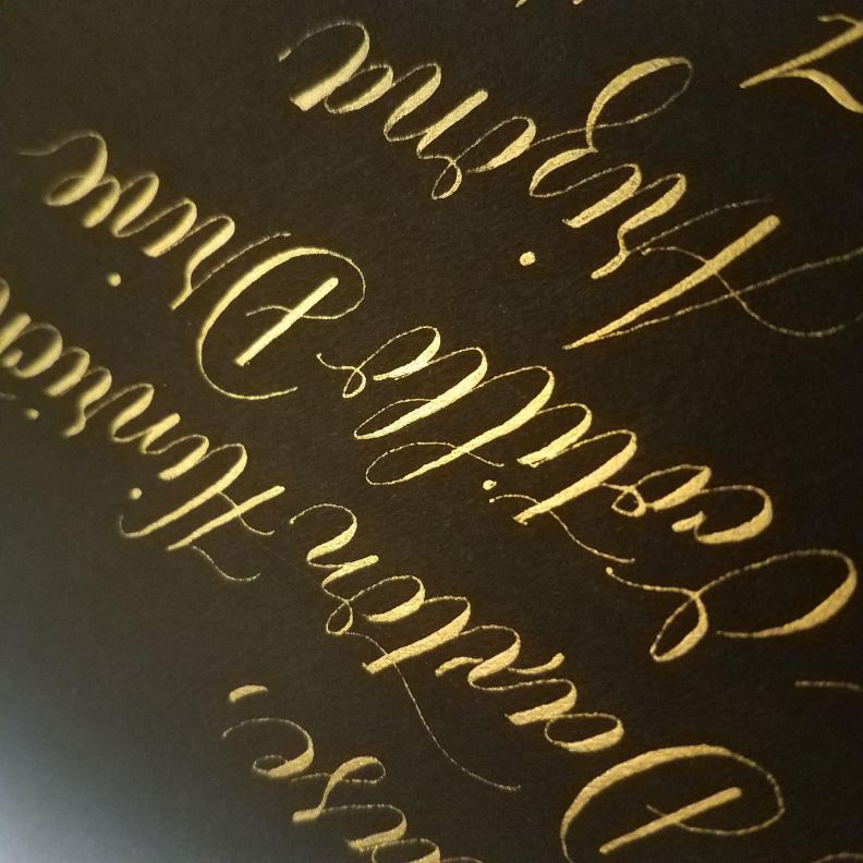 Gold Calligraphy on a Black Envelope