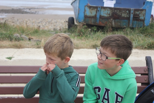 Boys waiting for sight of Dad in Saltburn