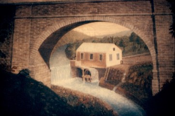 Painting by Frederick Agate, circa 1839, of Whitson's Mill, located to the east of the aqueduct arch. Shortly after this was painted a wooden bridge was erected under the arch to cross the Kill. The original painting is in the collection of the Ossining Historical Society.
