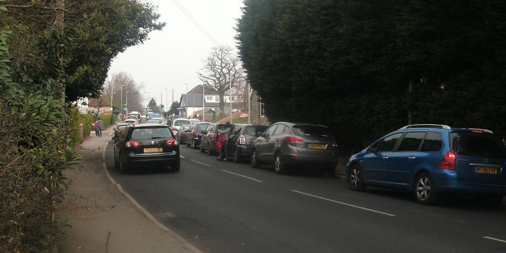 Parked cars outside Sir Henry Fermor school