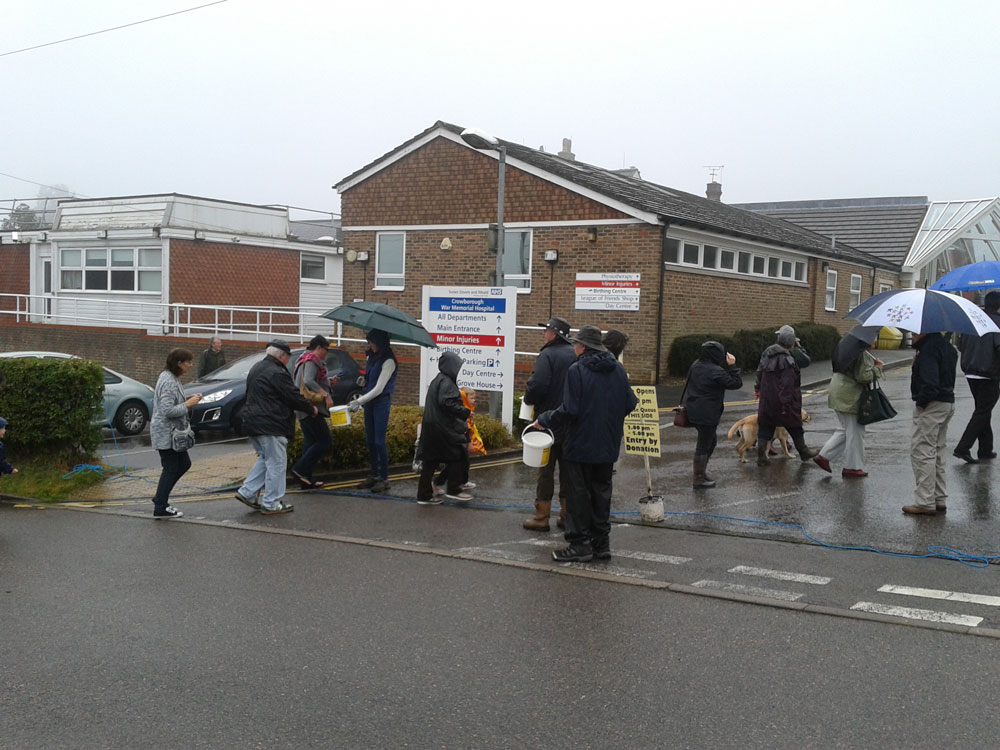 Volunteers collecting donations at the entrance
