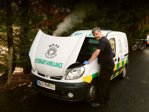 WRAS Founder Trevor Weeks with a broken down Ambulance