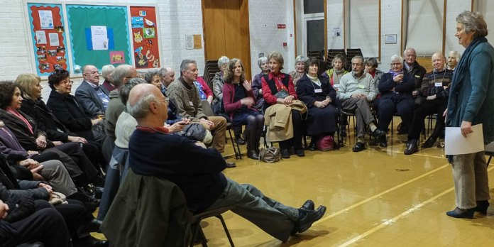 Volunteers hear the first Crowborough Foodbank annual report from Co-ordinator Freda Robinson.  Picture: Mike Raddenbury